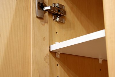 Concealed hinge and adjustable shelving inaide cabinet