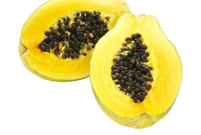 Papaya slices on white background