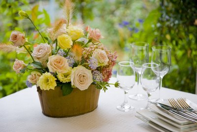 Flower arrangement in a basket on a table