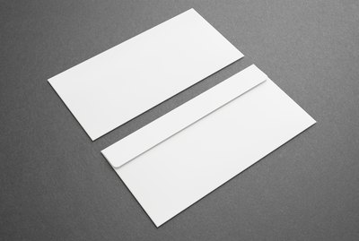 Blank envelopes on dark background. Front and back side.