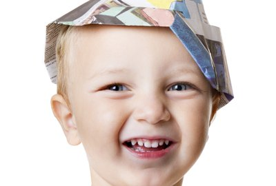 child smile with carpenter hat