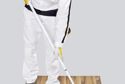 worker paint with primer wooden floor for waterproofing