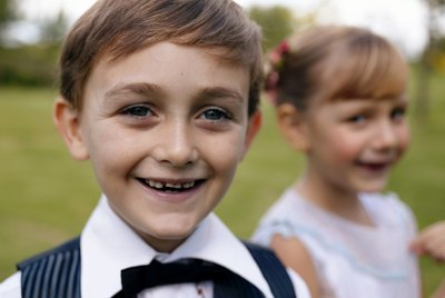 """""""Pageboy (6-7) with girl in background, smiling, close-up, portrait"""""""