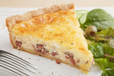Slice of Quiche Lorraine on a Plate with Salad
