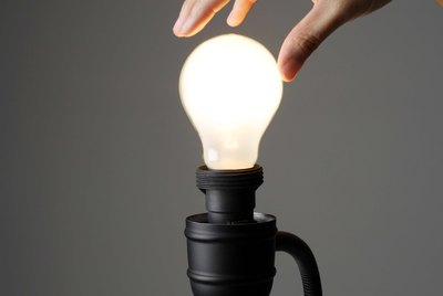 Hand on light bulb