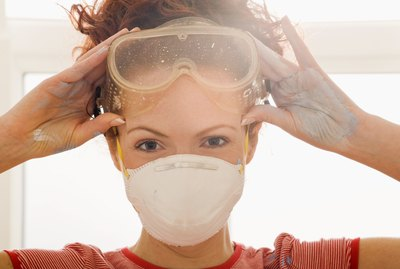 Woman in goggles and face mask
