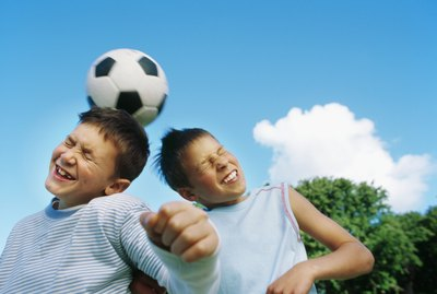 Boys (10-12) playing football