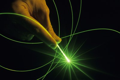 Fibre optics with laser; strand of optical glass , close-up