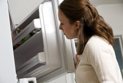 Woman looking in freezer