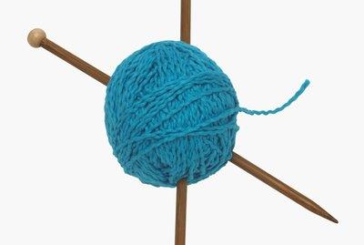 Ball of yarn and knitting needles
