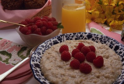 Bowl of oatmeal with raspberries and milk