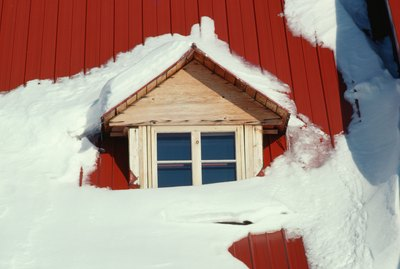 Snow covered roof of house