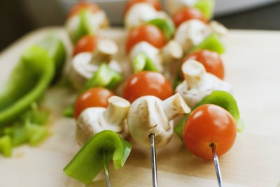 Shish kabobs on cutting board