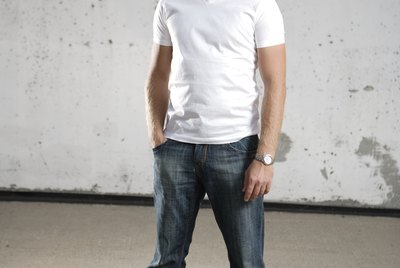 Man posing in bluejeans and t-shirt