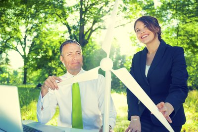 Business People Holding Wind Turbine