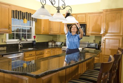 Cleaning Woman in Luxury Kitchen