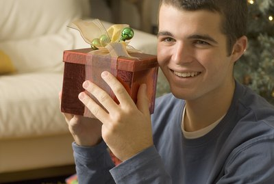 Teenage boy holding Christmas present