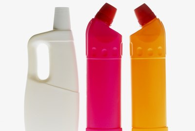 Close-up view of three cleaning product bottles