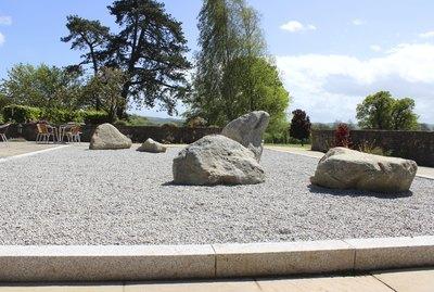 Image of Japanese Zen garden with stones, gravel, lanterns, maples