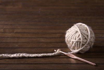 Ball of cream yarn with crochet hook