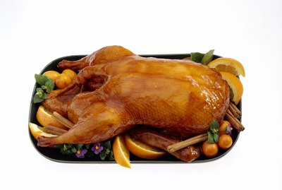 Glazed duck on platter with fruit