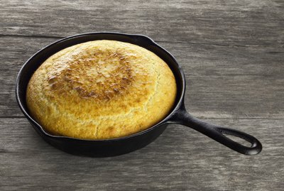Southern Cornbread In Black Cast Iron Skillet