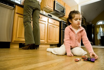Girl playing on kitchen floor