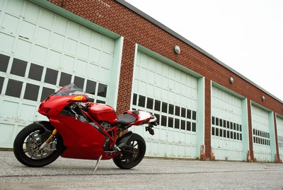 Motorcycle in front of garage doors