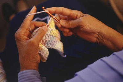 Woman crocheting, close-up of hand