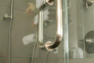Glass shower door with stainless steel handle