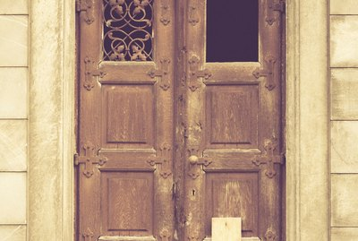 boarded up door to a crypt