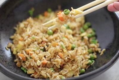 picking Japanese steakhouse fried rice up with chopsticks