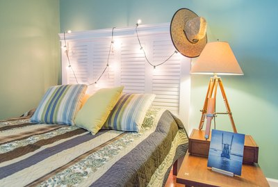Reclaimed shutters Queen-sized headboard creates a beach motif or shabby chic farmhouse decor.