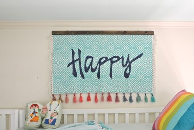 DIY hanging wall tapestry from throw rug