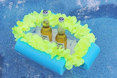 beverage boat floating in a pool with two beers
