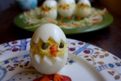 Deviled egg Easter chick on plate.