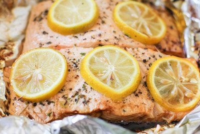 two salmon fillets in a foil packet