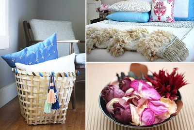 A storage basket, a bed and throw blanket, potpourri.