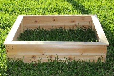 Build your own garden box out of cedar boards.