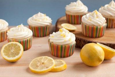 Lemonade cupcakes with lemon zest garnish.