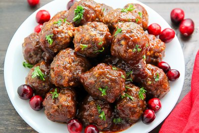 Moist meatballs covered in cranberry barbecue sauce.