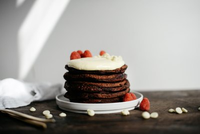 These Red Velvet Pancakes with Whipped Cream Cheese Topping are easy to make and delicious!