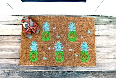Pineapple doormat made with free stencil printable template.