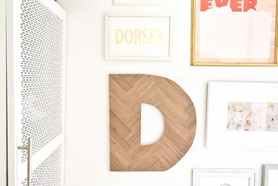 Herringbone letter hanging in gallery wall