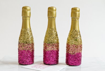 Glitter mini-champagne bottles.