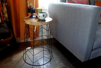 Side table made from a wire hamper and old chopping board.