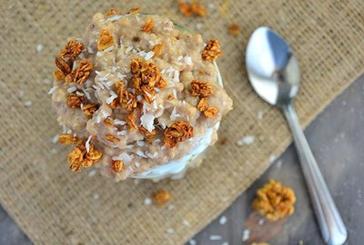 Coconut macaroon parfait topped with granola and coconut flakes.