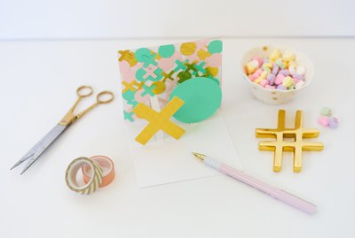 XO pop-up Valentine card with desk supplies and conversation hearts