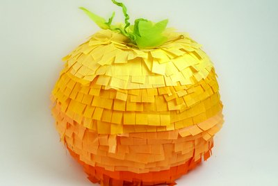 A large pumpkin piñata with 5 different shades of orange tissue.