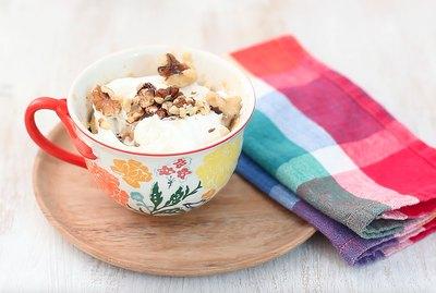 carrot mug cake garnished with walnuts